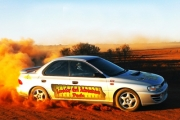 Tear Down the Tracks w/ Thrilling Rally Car Driving Experience! Enjoy 6 Laps in a V8 Holden or a Subaru WRX! Upgrade for 9 Laps or Pro Buggy Ride