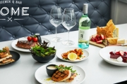 Enjoy a Night of Good Food & Good Vibes @ Home Kitchen & Bar w/ a 2-Course Dinner + Wine for Up to 4! Think Fried Chicken Bites, Lamb Belly & More