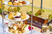 Treat Yourself to a Decadent High Tea Experience with Sparkling Wine for 2 at Lachlan's Old Government House! Sweet and Savoury Treats and More