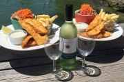 Meal Time Will Go Swimmingly w/ Fish, Chips, Salad & a Bottle of Wine for Two at Nino's Fish Bar! Choose from Two Waterfront Locations