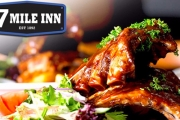 Whet the Appetite w/ Juicy Slow-Cooked Pork Ribs w/ Your Choice of Sauce, Battered Chips & Salad + Schooner of Beer/Glass of Wine at Seven Mile Inn!